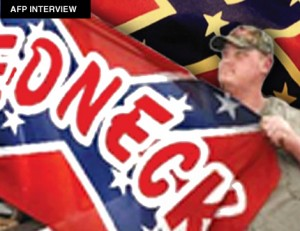 "Oregon resident Ken Webber displays the ""redneck"" flag given to him by his father and modeled after the rebel battle flag of the Confederate States of America in the mid-1860s. Weber, a school bus driver, refused to remove the flag from his personal vehicle after several requests. He was then fired. He is fighting the decision in court."