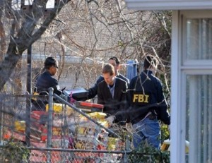Feb. 17, 2012  Members of the FBI and police remove packages from a shed behind a house in the Douglas Park neighborhood of Arlington. Authorities raided the red-brick rambler after the arrest of a Moroccan man in a plot to attack the Capitol.  Tracy A. Woodward / The Washington Post
