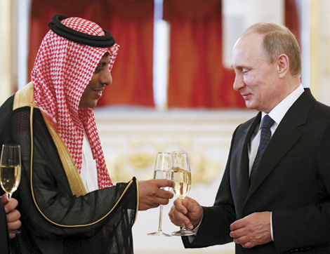 Russia's President Putin toasts with Saudi Arabia's Ambassador to Russia Al-Rassi after receiving a diplomatic credential from him during a ceremony at the Kremlin in Moscow